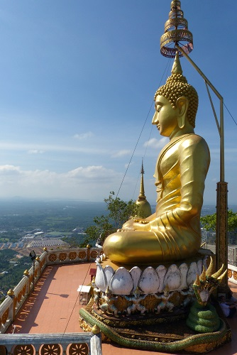 Golden Buddha and view from the summit at Krabi Tiger Cave Temple, Thailand