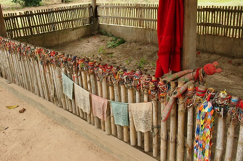 Fence around a mass grave at Choeung Ek Killing Fields, Phnom Penh, Cambodia