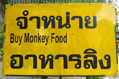 Buy monkey food sign at Krabi Tiger Cave Temple, Thailand
