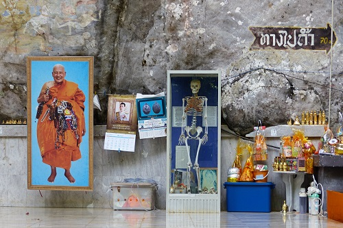 Human skeleton and monk photo at Tiger Cave Temple, Krabi, Thailand