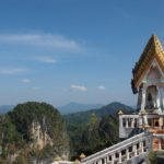 Summit shrine with limestone karst behind at Tiger Cave Temple, Krabi, Thailand