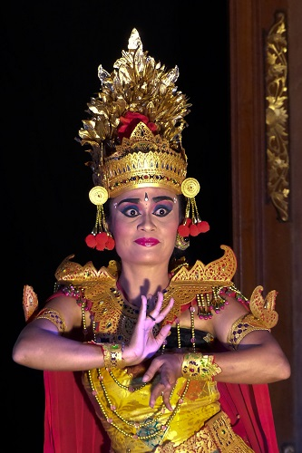 Balinese dancer with elaborate headdress at Ubud Palace in Bali
