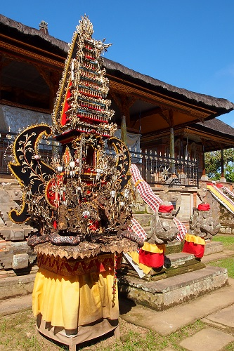 Balinese offering tower of carved pork rind, pom poms and pig's head in Pejeng, Bali, Indonesia