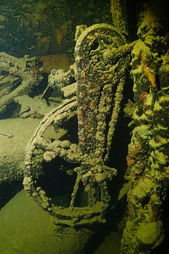 Bicycle hanging in hold of Kiyosumi Maru wreck in Chuuk Lagoon, Micronesia