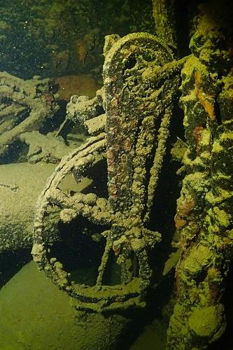 Bicycle hanging in hold of Kiyosumi Maru wreck in Chuuk Lagoon, Micronesia