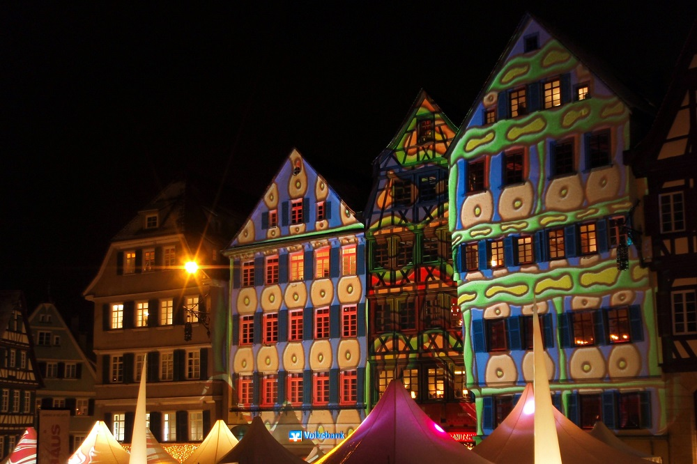 Patterned lights projected onto traditional buildings at ChocolART chocolate market in Tübingen, Germany