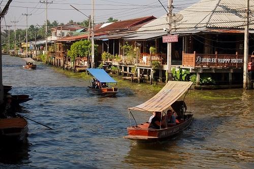 Tourist boats cruising around Damnoen Saduak town in Thailand