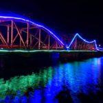 Entanou bridge lit up at night in Kampot, Cambodia
