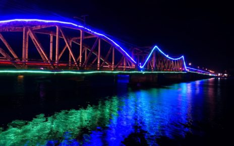 Entanou bridge lit up at night in Kampot, Cambodia