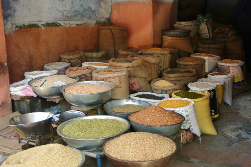 Open sacks of pulses and grains at a shop in Jaipur, India