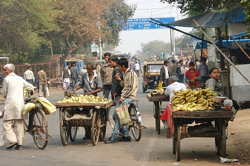 Fruit stalls on a busy road in Fatehpur Sikri, India