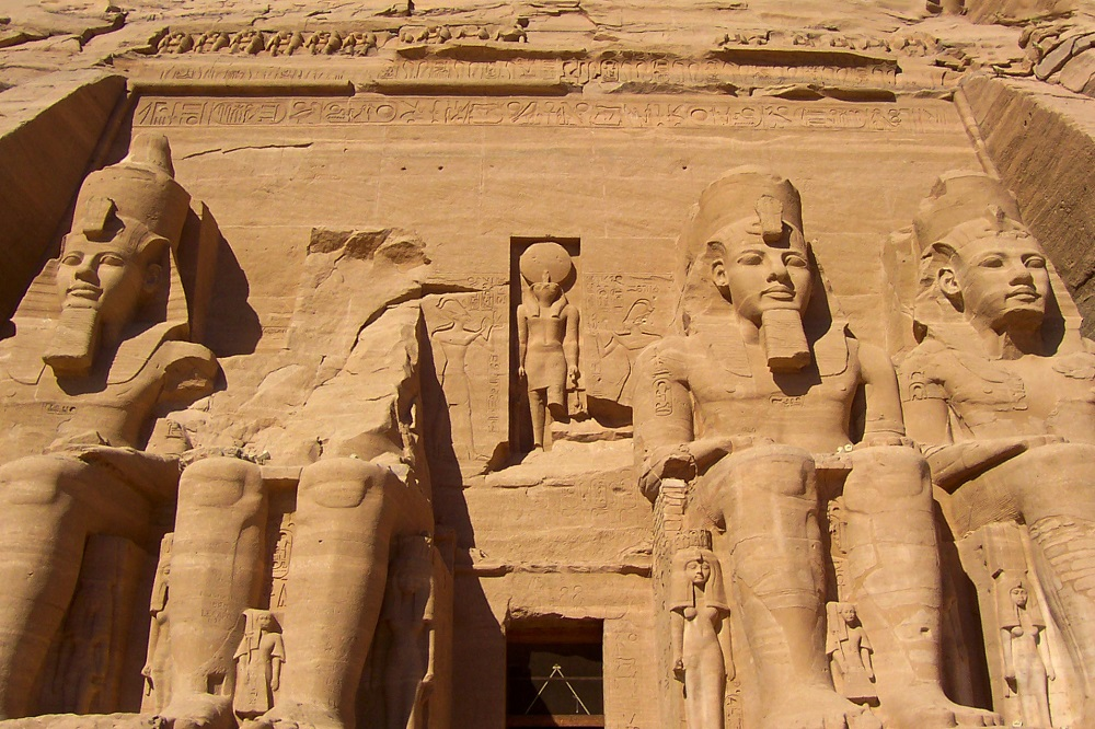 Large seated statues in front of the Great Temple of Ramesses II in Abu Simbel, Egypt
