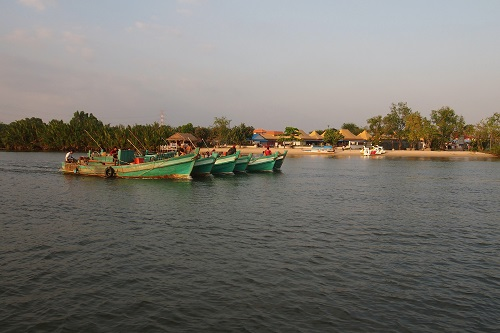 Fishing boats on river in Kampot, Cambodia