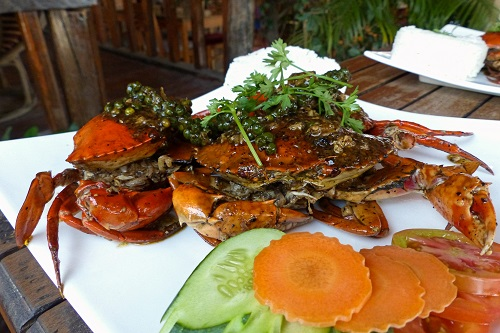 Plate of crabs covered in pepper in Kampot, Cambodia