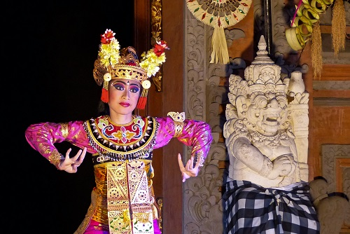 Legong in pink and gold costume at Ubud Palace in Bali