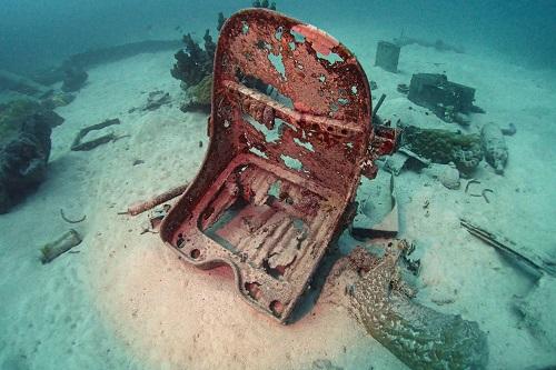 Pilot's seat on seabed near Betty Bomber, Chuuk Lagoon, Micronesia