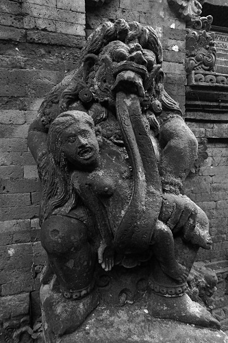 Statue of Rangda with her tongue wrapped around a child at Ubud Monkey Forest, Bali