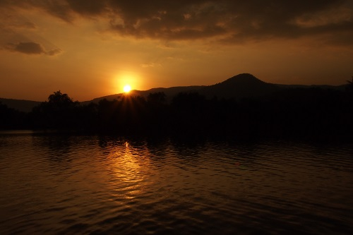 View of river and mountains at sunset in Kampot, Cambodia