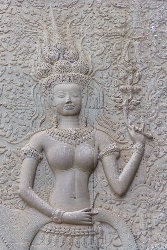 Smiling Apsara carved on wall of Angkor Wat temple near Siem Reap, Cambodia
