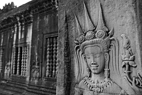Face of smiling apsara at Angkor Wat temple near Siem Reap, Cambodia