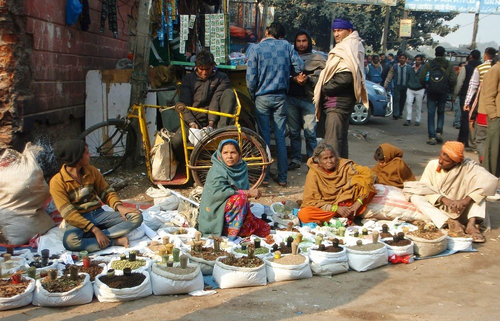 Women selling spices at roadside in Delhi, India