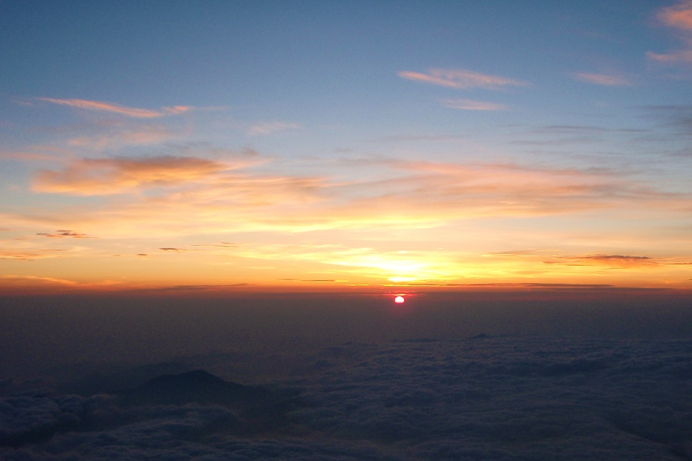Sunrise above the clouds seen from Mount Fuji, Japan