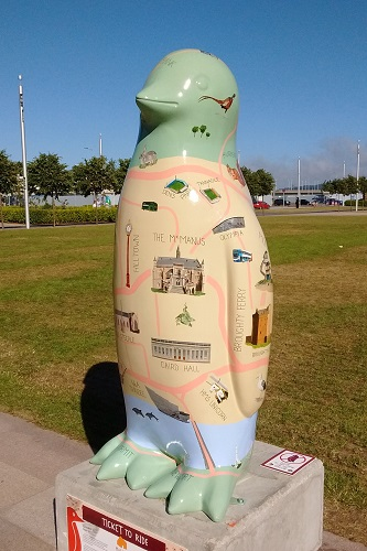 Dundee map themed penguin statue in park at Maggie's Penguin Parade, Scotland