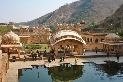 Pool of holy water and domed roofs of Galtaji in Jaipur, India