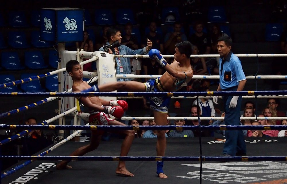 Fighter dodges during Muay Thai fight in Bangkok, Thailand