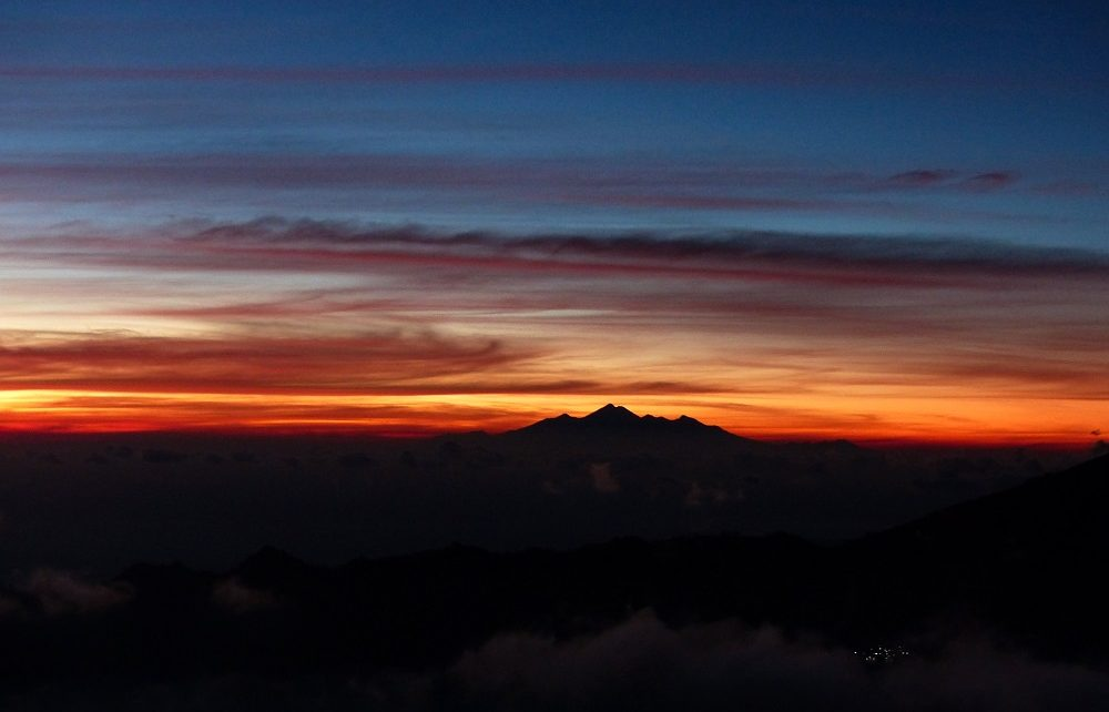 Red sunrise sky seen from Mount Batur in Bali, Indonesia