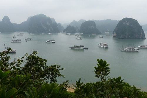 Ti Top Island and view of cruise boats on Halong Bay, Vietnam
