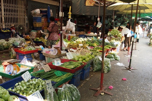 Fruit and vegetable stalls at Khlong Toei Market in Bangkok, Thailand