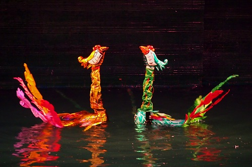 Two phoenixes on water at Thang Long Water Puppet Theatre in Hanoi, Vietnam