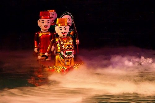 Puppets in a boat at Thang Long Water Puppet Theatre in Hanoi, Vietnam