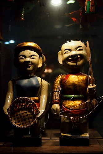 Two water puppets in glass case at Thang Long Theatre in Hanoi, Vietnam