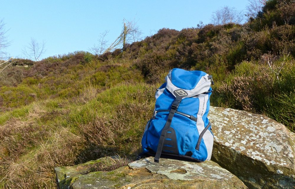 Blue backpack on a rock in Lancashire, England
