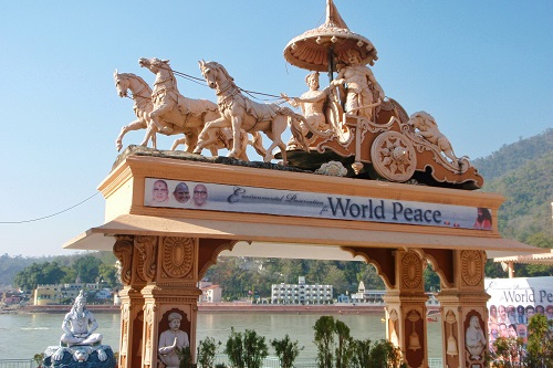 Archway with statue of chariot and horses on top in Rishikesh, India