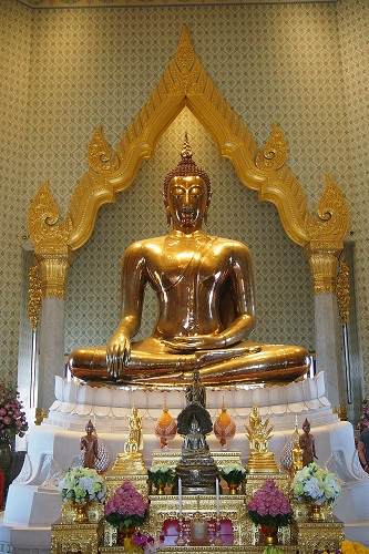 Seated golden Buddha at Wat Traimit temple in Bangkok, Thailand
