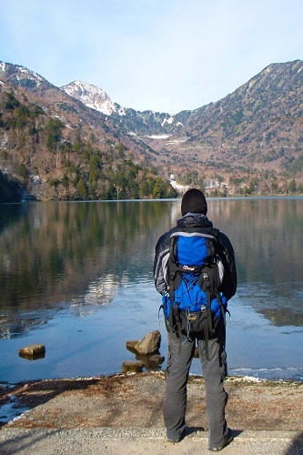 Chris with blue rucksack by Lake Yunoko, Japan