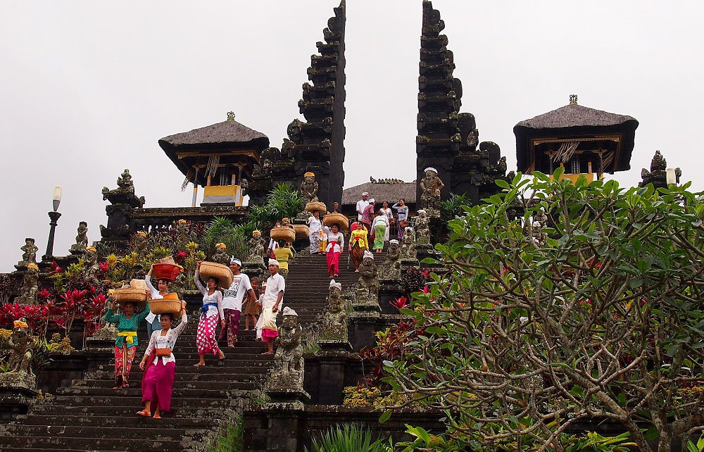 Worshippers climbing steps to main temple gates at Pura Besakih in Bali, Indonesia
