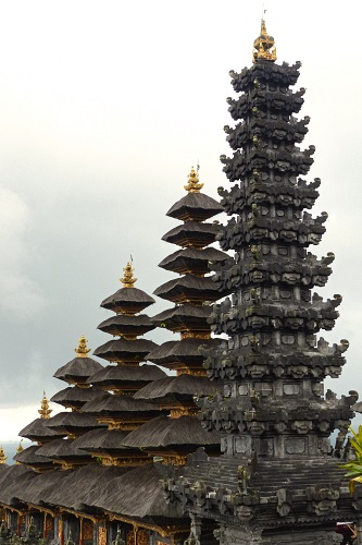 Row of 5 pagodas increasing in height at Pura Besakih temple in Bali, Indonesia