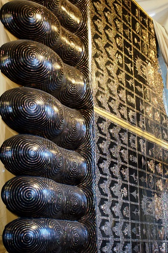 Feet of the reclining Buddha at Wat Pho temple in Bangkok, Thailand