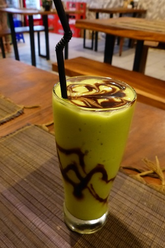 Glass of avocado juice with chocolate sauce in Bali, Indonesia