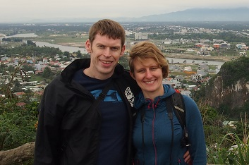 Chris and Maddy with view from Marble Mountains in Vietnam