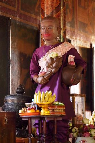 Cross-Dressing Buddha statue at Wat Phnom, Phnom Penh, Cambodia
