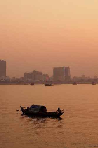 Fishing boat on the Mekong river at dusk in Phnom Penh, Cambodia