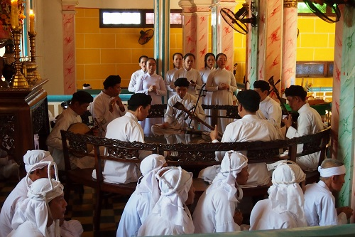Musicians playing at Cao Dai Holy See temple in Vietnam