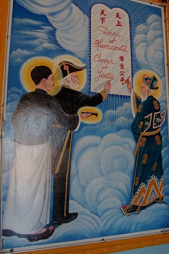 Picture of three saints writing a covenant at Cao Dai Holy See in Vietnam