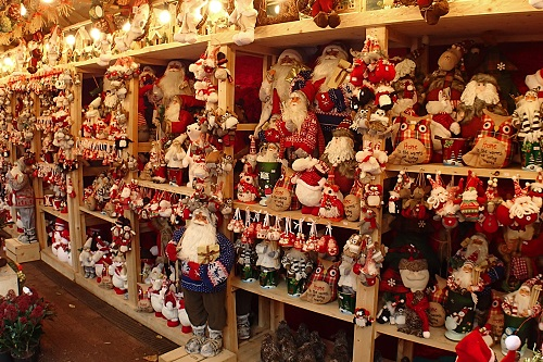Shelves stacked with Santa figures at Manchester Christmas Market in England