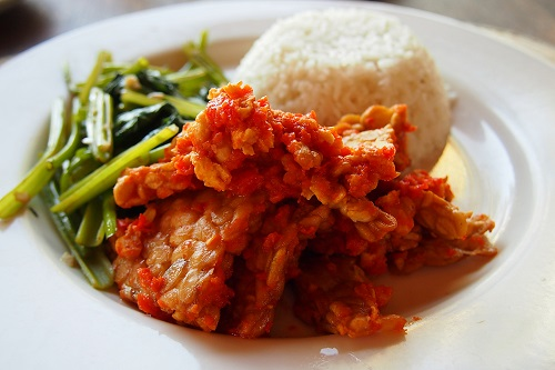 Tempe Plecing with vegetables and rice ready to eat in Bali, Indonesia